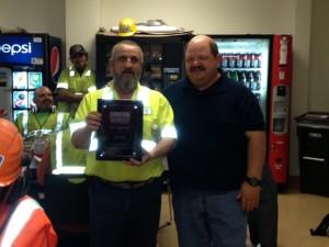Dimas Vaz receives an award for Outstanding MRF Fire Control.